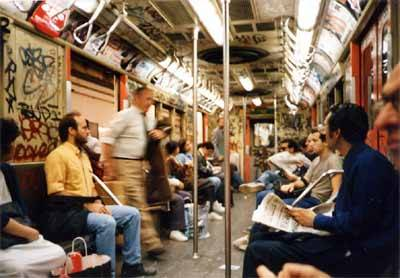 Tumblr reblog fromthecityofnewyork:  NYC subway 1986  I post this hideous photo of what the subway looked like back then, only to emphasize how sleek, clean, and awesome the subway is now. (Even the slightly decrepit ACE line is better than this.) There are things it could do better, but the subway system is one of the best things about living in New York.