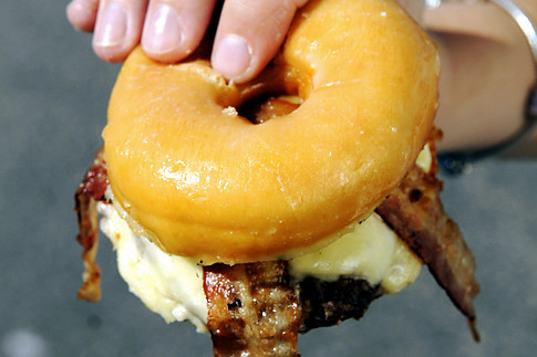 Meet the 1,500-calorie 'Craz-E Burger': beef patty, bacon and cheese on Krispy Kreme donut! Talk about a heart-stopper. The donut burger - a bacon cheeseburger with a buttered Krispy Kreme glazed donut standing in for a bun - is becoming a hit on the fair circuit and among some far-out foodies. [x]