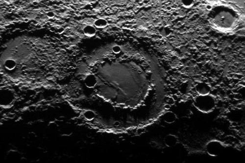 A Double Ringed Basin On Mercury What created the internal second ring of this double ringed basin on Mercury? No one is sure. The unusual feature spans 160 kilometers and was imaged during the robotic MESSENGER spacecraft's swing past our Solar System's innermost planet last week. Double and multiple ringed basins, although rare, have also been imaged in years past on Mars, Venus, Earth, and Earth's Moon. Image credit: NASA/JHU APL/CIW (via APOD)