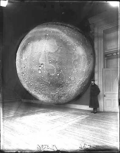 "in-circles:  misstugui:  unpalombaro: Moon Model Prepared by Johann Fried, Germany, in 1898. Made of 116 sections of plaster on a framework of wood and metal. Wood floor, security Guard in uniform in background, stairs leading up to the left. Sign above door ,""Geology,"" not completely visible. Field Columbian Museum West Court Alcove 103. 1898._   *adds ""colossal moon model"" to Christmas wish list*"