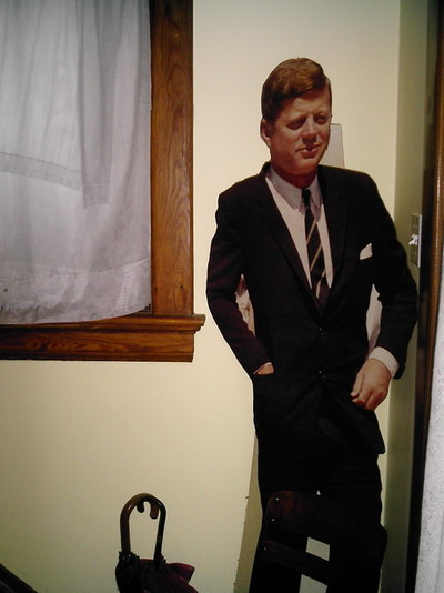 "On October 12, 2008, I posted the above photo of a JFK cutout in my uncle's foyer in Cincinnati — the same house my dad grew up in. This was the first posting to southtwelfth.tumblr.com. One year old today! What an auspicious beginning, too. That photo summarizes so many of the recurrent themes here at S. 12th: the enduring influence of extended family the triumphs and limitations of 20th Century American liberalism discussions of artifice and visual representation handsome men wearing neckties and pocket squares walking in and out of front doors interior decorating issues Probably more, too, but I'm so gut-wrenched with utter excitmement that my critical thinking skills are failing me. That is why, on this most exciting and mindless of anniversaries, I am flinging the brass-beknobb'd front door of S. 12th wide open to you, the reader. Come root around in my foyer and mess with my uncle's JFK paraphenelia. I have activated the ""submit"" feature, meaning you may click here and post your thoughts to this very tumblelog about the many ways S. 12th has inappopriately touched you in the past year. Happy first year, reader!"