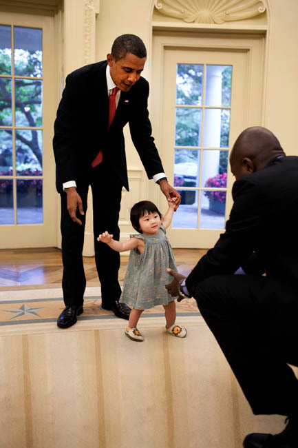 emiiiiiiiiiiily:briahere:ginaunfiltered:   President Barack Obama helps his niece, Savita, as she begins to walk towards the President's personal aide Reggie Love in the Oval Office on Sept. 17, 2009. (Official White House Photo by Pete Souza)