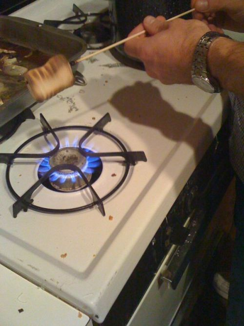 Stove-top s'mores.  A fun solution for dessert last night, after our first attempt (culinary blowtorch s'mores) was a little too intense!  On the other hand, I don't recommend the fat-free, gluten-free marshmallows from Whole Foods, but you go to war with the marshmallows you have, right?