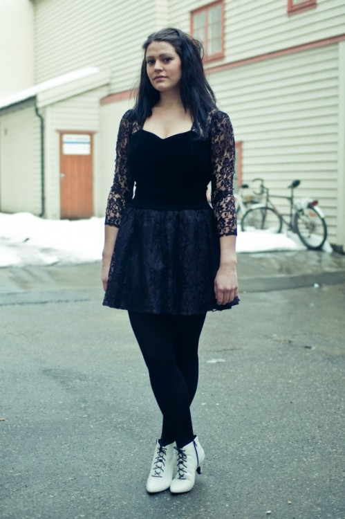 Lace dress, black tights, and white shoes in Oslo.