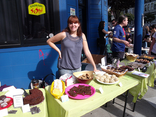 This week's SF Vegan Bakesale earned over $2,600 (IN ONE DAY) for Give Me Shelter Cat Rescue!!! Give Me Shelter also adopted out two cats!!!! SO RAD. I am still in shock about the amount of money we made, was totally expecting to make around $1,500 but DANG. We would have made more if we didn't completely run out by 2:30 pm. NIGHTMARE. With over 50 bakers, I didn't think that would be possible but people TURNED IT OUT. So all that means is that next time, we need YOU! to bake. It doesn't have to be fancy-fancy. Everyone can make cookies, right? EVEN YOU. Oh and the San Francisco Committee for Human Rights in the Philippines (SFCHRP) collected $193.00 for victims of  Typhoon Ondoy (a.k.a. Ketsana). Plus, lots of clothing and relief goods!! They are obviously looking for more so if you are interested in donating, please contact them! It's impossible to thank everyone involved but I'll give it a go. Let me know if I left you off the list. It's because I am not totally with it ever BUT Super Special Thanks to:  VegNews magazine, À Côté Restaurant, Sugar Beat Sweets, Violet Sweet Shoppe, Idle Hands Baking Company, Cinnaholic (who we heard also won FIRST PLACE & photographers choice at the SF Food Wars Mini Cupcake Clash on Sunday! Congratulations!!!),  Fat Bottom Bakery, Pure Life Chef, Mood for Food/Philip Gelb, Avi's Vegan Treats, Laura Lemon, Brassica Supper Club,  Ike's Place, Love All Beings, Say It's Not Soy, It's Faturday, Vegan Homemade, I eat cupcakes, UGH I KNOW I'm forgetting people. Amazing people. Crap. Email me if I don't have you on here and I'll add you asap! Also email me if you're interested in participating in the next one, we're thinking sometime around the holidays. Let's DO THIS. The photo is from/of one of our awesome organizers, Sharon from Veg-Table, showing off the delicious wares! She has some other great photos in her flickr, so check them out!