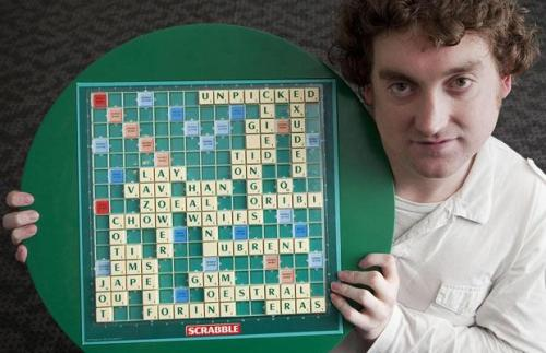 Awesome Scrabble words: Craig Beevers holds his winning board after beating David Webb 3-0 at the 38th National Scrabble Championships.