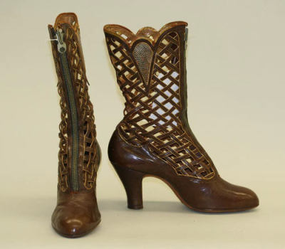 What GORGEOUS boots these are! The detailing is fantastic and surprisingly modern with the cut-outs and zipper up the front. These are Belgian leather boots, and can be found at the Met Museum.