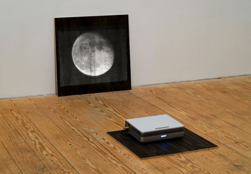 Hand Held Moon by Anne Eastman, 2009. Single channel digital video loop, no sound, projected on black wood board. (via VVORK)