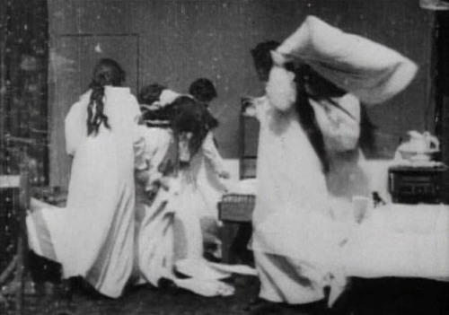 "Girls Gone Wild, Turn of the Century Edition: Still from Seminary Girls (1897, Edison Manufacturing Co.) In addition to the invention of the ""Kinetograph"", a motion picture camera, and the ""Kinetoscope"", a peep-hole viewer where people could watch short films, Thomas Edison's lab produced numerous films, including Seminary Girls in 1897. Only 30 seconds long, it features six girls pillowfighting until they are caught by their teacher. Film can be seen on youtube here."