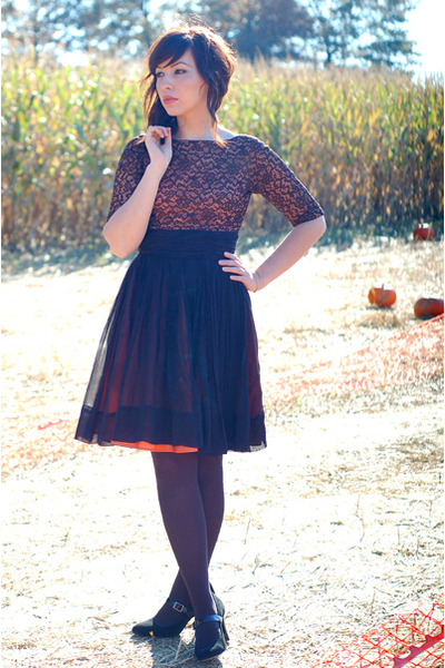 Vintage lace dress, black tights, and heels at a pumpkin patch.