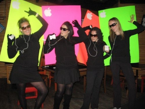 Halloween 2007: iPod Commercial. I was the pink one. Obvy. Our backgrounds were a bitch to maneuver in at the bar, but also hilarious.  One year we were also the ninja turtles, our outfits were epic, but sadly I don't have a photo of them on my work computer. This year for Halloween? Trolls!! I'm super excited!! I'm also pumpkin carving tonight and cupcake baking. Every-thing's coming up Milhouse this weekend.