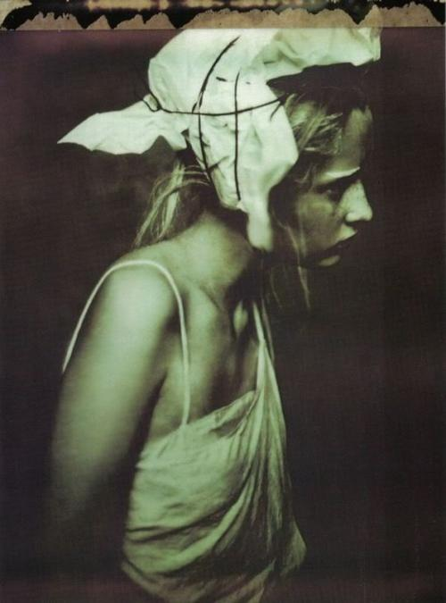liquidnight:  Paolo Roversi - Ritratti di Allora  Perfect Headgear of the Day XXVIII Yes, of course it's only greasy fish 'n' chips paper and a rotten shoelace stolen from a homeless orphan, but if you wear it with conviction, it's clearly a winner, as you can see.