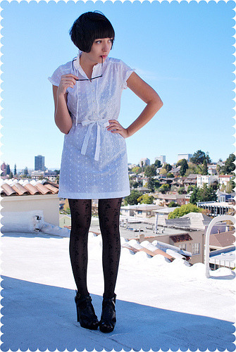 Vintage white dress with black tights.