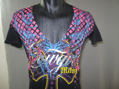 Custom engineered print for a deep v-neck. This includes a foil running over the seams which is very difficult to achieve. Nice job by our in house graphic designers!