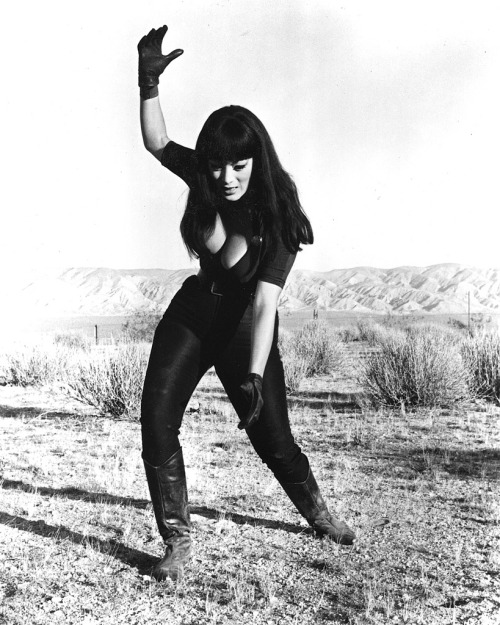 "Tura Satana as Varla in Faster, Pussycat! Kill! Kill! (1965, dir. Russ Meyer) via Big Bosoms & Square Jaws:The Biography of Russ Meyer by Jimmy McDonough: ""She knew how to handle herself,"" said Meyer. ""Don't fuck with her! And if you have to fuck her, do it well! She might turn on you!"" In fact, the right for intercourse was Satana & Meyer's first battle. Once shooting was about to begin out in the desert, Meyer informed her of his production code: no connubial bliss. ""I can't do that,"" said Satana matter-of-factly. ""What do you mean, you can't do that?"" barked Meyer. ""You better find somebody else, because I need it every day, and if I don't get it I get very cranky. If you want me to give you a good performance, I need to be relaxed. And that relaxes me."" ""I knew she had me by the balls, because I couldn't very well discharge her,"" RM moaned later. He relented to Miss Satana, and it wouldn't be the last time. But, Meyer had to ask, just who was going to fill her need way out here in the desert? ""Not you,"" she shot back. ""You're the director and you're the producer. I'll find somebody, even if I have to pull a gas jockey somewhere."" She settled for the assistant cameraman. ""Gil Haimson was my stud,"" she recalled, laughing. Meyer made her swear not to reveal to anyone else what she was getting away with. Haimson blushed when asked to confirm. ""I didn't conquer Tura. I was set up!"" he blurted out. ""Tura came on to me. I said, Russ'll have a fit!"" Gil had no idea that RM was in on the deal until decades later. ""I went over to see Russ and said, ""I've got to apologize for something."" When Haimson confessed, Meyer started howling with laughter. ""You son of a bitch! You were set up, Gil!"" Satana was one of the mighty few who ignored Meyer's no sex decree, and she always felt that RM was a little miffed she didn't choose him for a roll in the hay."