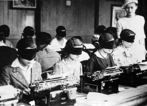 liquidnight:  Blindfolded Typing Competition, Paris, France, circa 1940 [via Foxtongue] (via mechanicalbirds)  This, my deers, is how I learned typing. Listening to Army of Lovers' Crucified* as deliberate distraction to the beat of the typing metronome, to be precise. This, my deers, is why I master the 10-finger-system like no other and why I can type faster than the speed of light without ever actually looking at the keyboard. And this, my deers, goes to show how bloody old I am. o_O * WTF was wrong with my typing teacher?!?