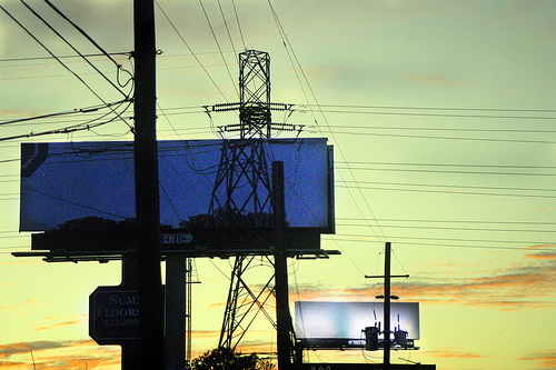 "From synecdoche on Flickr, an art project in Houston: Using 13 billboards along the city´s downtown freeways, Olivier will replace the usual advertisements with images of the urban landscape that would be visible if the billboard did not exist - the sky, trees, and buildings obstructed by the ads will now be ""revealed.""  Having been to the southern US, I can certainly recognise the pattern synecdoche describes in the description of another photo of a billboard from the project: Houston is a city of billboards and big signs, sprouting everywhere above the highways in gleaming, glaring, blinking, clashing profusion. A billboardless vista is rare; in traffic-dense commuter areas there are so many that they cancel each other out, becoming visual background noise. Even on a relatively deserted stretch of highway there will be at least one or two every half-mile or so. That makes this project, time-limited though it is, even more wonderful."