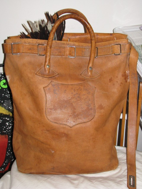 It's On Ebay! Vintage leather bag circa 1940s.  Probably a banker's bag.  Perfect for a tote or a carry-on bag.  I happen to know the seller of this piece - it's my mom.  She's trustworthy.  She sent me this after she picked it up from an estate, and I was blown away.  Billykirk and Freeman's Sporting Club made a pretty version of this in heavy canvas, but this is the real deal. Starts at $85, ends Wednesday