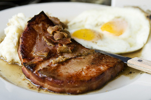 jojochao:  ham steak, mashed potatoes, red eye gravy, and fried eggs  Mashed potatoes with gravy at breakfast? Before we even get to the steak this spread is already revolutionary.