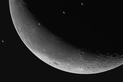 ISS transits the moon (credit: Bernhard Christ via BadAstronomer)
