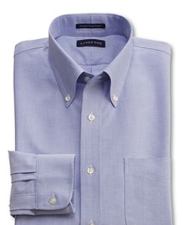 """Eight Days of Style Reader Lucy wrote to us to ask that we suggest eight super-basic, affordable Hanukkah gifts for her boyfriend """"to replace his stained light-wash jeans and Nine Inch Nails t-shirts."""" We'll offer one choice for each day the oil burned. Above: the Lands' End Hyde Park Tailored Fit Dress Shirt in blue. A simple button-down with a solid fit and good construction for $30. A solid layering piece if ever such a piece there was."""