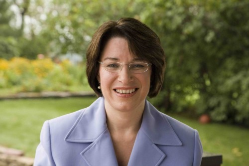 Senator Amy Klobuchar, Senior Senator from Minnesota, without need for any public debate, is hearby named the hottest member of the 111th Congress. She wants to stop cellphone companies from charging you exhorbitant fees when you cancel your contract. She's a frequent guest on the Rachel Maddow show. She's got a Minnesota accent. Glasses. Let it be known that I, the editor of this blog, would totally fuck Senator Amy Klobuchar for the above stated reasons.