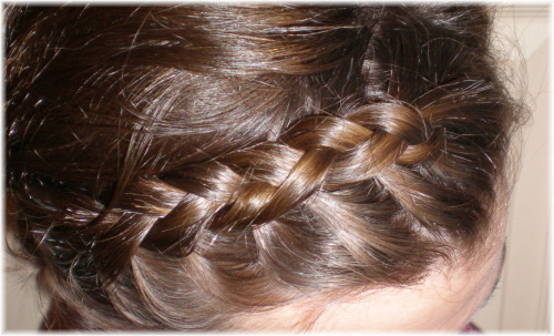 A couple people asked me about the braid in my hair yesterday, since it is no where near long enough to even pull back into any kind of pony tail. Yes, it is my real hair. Yes, I braided it myself. When your hair is short a braid is still possible. Instead of braiding in the normal french-braid way, try doing an inside-out french braid. The basic tenant for this is that the middle section is the one that does the crossing over on top instead of the end pieces. Also braid your hair wet, after applying a frizz-reducing product. (I use either an Herbal Essence Mousse or John Frieda's Frizz-Ease smoothing creme, but use whatever works for you.) I've found that an inside out allows for two things that are key for braiding short hair. One: the braid stands out a little more so it is actually visible even if it is small. Two: it is easier to bobby pin flyaways into the braid when it's styled this way. Don't know how to braid? No problem. I taught myself, after a lot of practice, by using the Klutz braiding book. It gives you detailed instructions on how to do a variety of braids and it illustrates the finger placement, which is KEY when braiding.
