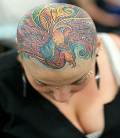 Peacock tattoo via Found Shit Tattoos on the head are so cool. But that would mean I'll have to shave my head… no thanks, I'll skip. People with beautiful features should totally do this!