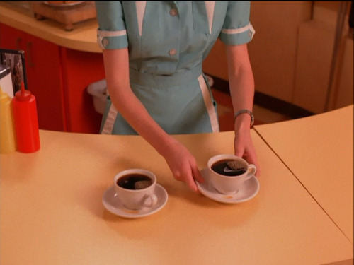 geaphiles:  I blame this show for my coffee addiction thewardress:  David Lynch and Mark Frost -Twin Peaks Episode 6   So do I. I had a nervous breakdown in the 2nd term of my 5th year at uni after drinking around 1.75 litres of strongest black Lavazza a day for an entire year. My blood was as dark, sticky and thick as oil slick. I was inspired by both Twin Peaks and reading on the interwebs that Honoré de Balzac drank up to 3 litres of coffee a day. It took about a year for the migraines to go away. Oh, Dale Bartholomew Cooper, you massive bastard! NB: I apologise for re-blogging Twin Peaks related material. I'm aware of the fact that Tumblr has officially killed Twin Peaks, but the colours in the still above are just too gorgeously sumptuous and I know that Gregory Crewdson would approve too.