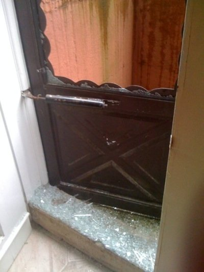 My poor door after the brick was thrown through it