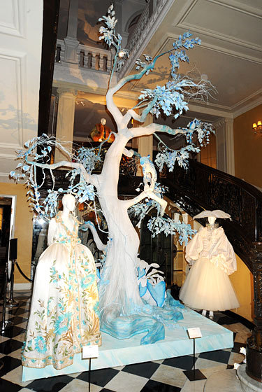 John Galliano's take on a Dior Christmas Tree. The inspiration was snow scenes with a tropical twist, which explains the lack of a pine tree and with leopard, parrot, and dragonfly adornments. While the tree lacks in branches, tinsel and baubles, it makes up for in couture. Galliano handpicked 20 couture gowns from the Dior archives to go along with the display. Amazing. Wish I coulld be there.