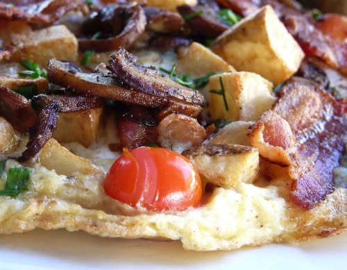 Bacon, Mushroom, Tomato, and Potato Frittata   from Thibeault's Table via aperfectspread