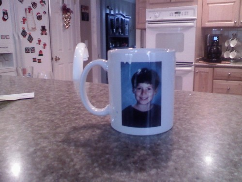 natmelfrankmoby:  Perks of living with your parents: coffee mug with your 5th grade picture on it.  sweeeeet. thank goodness there are none of these floating around MY mom's house!