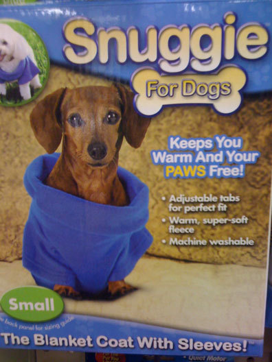 "Dogs need Snuggies too! I know you might be thinking, ""This is CRAZY (stupid),"" but come on! It keeps them warm—especially necessary in this chillywilly SF weather—and leaves their paws free to do other things. Activities pictured on the package include changing the television channel, eating popcorn, playing backgammon, and smoking ciggies (JK smoking's bad for you). Snag yours at Walgreens for only $10, and give the gift of fleecy love to your favorite canine. While you're at it, get yourself a human version (It's the fanny pack of 2009! And 2010! That doesn't even make sense!), take a photo, and submit it to one of those ""I look like my companion animal"" competitions. You know you want to, fame whore."
