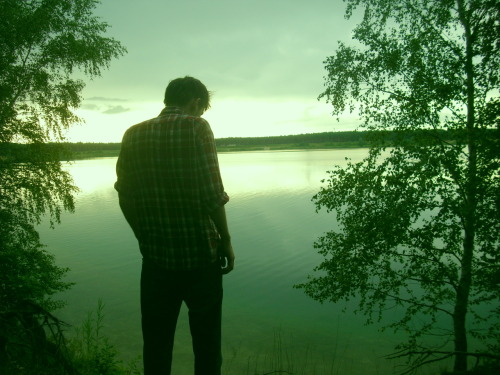 This is a photo I took of my friend Kes standing in front of the Helene lake near my hometown in East Germany.