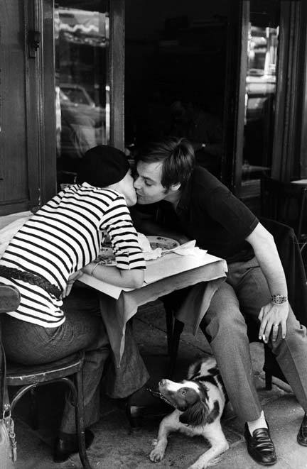 "Boulevard Diderot / Paris 1969 by Henri CARTIER-BRESSON MOTHER DECIDED TO STUDY ABROAD. Coming from a well to do family in Mexico that was all too eager to finance the expansion of her horizons, she decided on Paris. Above all, fashion was the most important endeavor in mother's life. She dreamt of walks along Les Champs Elysees, sketch book in hand, designing couture that would pull at the heart-strings of sixteen year old girls across the globe. Grandmother produced the post cards from her bureau's bottom drawer. Furiously shuffling through them as though she was working her well worn Rolodex, she settled on one depicting the Louvre and withdrew it from the stack. ""Here it is,"" she said in Spanish. Handing it over for my review, grandmother said ""this was the defining moment that brought you into this world."" I inspected the well worn post card briefly. I then turned it over. It read: ""I'm sorry. I'm not coming home."" It was just an average Tuesday like any other. Cloudy skies, the roar of cars and motorcycles echoing from the nearby tunnel, the bakers and butchers selling their wares on the street as he stepped out of the metro. Father was a practical and calculated man in both thought and emotion. Walking up six flights of stairs that lead to his destination, the furthest thing from his mind was any nuance of true love or destiny. ""It's for the birds,"" he would often say to his close Parisian friends over drinks. He believed a series of chemical reactions in the body caused the ""illusion"" of love. A presumably forward thinking man, he shunned most commonly accepted concepts and practices. This included love and religion. Walking through the front door of his sister's house while simultaneously removing his scarf, father and mother locked eyes. He was converted. Instantly."