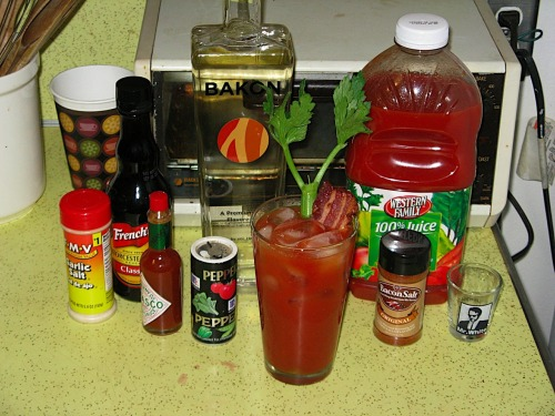 No holiday party is complete without the Bacon Bloody Marys! Here's the recipe we used: Shot-and-a-half of Bakon bacon vodka Dash of Tobasco Few dashes of Worchestershire sauce Dash of pepper Dash of garlic salt Few dashes of J&D's Bacon Salt Fill to rim with tomato juice Garnish with celery and slice of bacon
