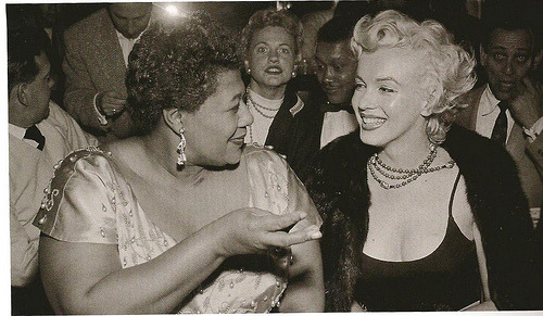 "Marilyn with Ella Fitzgerald listening to jazz at Hollywood's Tiffany Club in 1955. Ella Fitzgerald had become her favorite singer, and when she found out that a popular club had refused to book Ella because she was black, Marilyn took action. Quote from Ella: ""I owe Marilyn Monroe a real debt. It was because of her that I played the Mocambo, a very popular nightclub in the '50s. She personally called the owner of the Mocomabo, and told him she wanted me booked immediately, and if he would do it, she would take a front table every night. She told him - and it was true, due to Marilyn's superstar status - that the press would go wild. The owner said yes, and Marilyn was there, front table, every night. The press went overboard. After that, I never had to play a small jazz club again. She was an unusual woman - a little ahead of her times. And she didn't know it""."