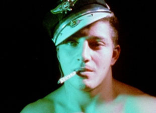 "Kenneth Anger Living Legend I was downtown when I got the call to see Anger's films at the SFMoMa on Thursday night from my artist friend Jonathan Casella. At first, I was a little hesitant, as I had seen a lot of his films before, but so glad that I went as to my TOTAL surprise, he came out on stage to introduce the films in this amazing red sweater, which I deciphered said ""ANGER"" in relief knit, so cool. It was a rare encounter and thrill to hear him after speak about how he edited the Jesus footage into Scorpio Rising: ""I was in the middle of editing, and I received this package in the mail. I thought it was a film can returned to me from a film festival, but it was actually a mistake that was supposed to be sent to the Church a few blocks over with the same address. I took it as a sign from God, and edited it in, kind of satirizing people who follow false allegiances."" Righteous! I'm psyched for the Maya Deren screening here. She is my ultimate film hero. Thanks to SFMoMa for bringing Anger out and to Orion for hooking it up. Still from Scorpio Rising above. -B.Nguyen, Founder"