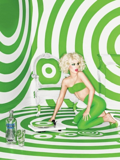 A very blonde Kate Beckinsale trapped in a psychedelic world of green Target logos for Absolut Vodka ad campaign.