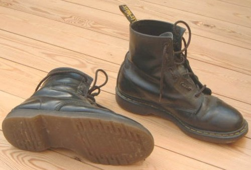 "Q and Answer: Dr. Martens J.C. askes: I love my Doc Martens (classic black 8 holes)—they're solid shoes, have lived through several moves, jobs, era's of my life, and numerous repairs. I have been told, however, that they are not exactly a fashionable boot. Is this true? I've always assumed that they were at least not embarrassing shoes/boots, but I'm worried that such may not be the case.  If they are an embarrassment, do you have suggestions for something as durable and comfortable that is also a bit more fashionable? Dr. Martens are indeed a classic.  We learned from Quadrophenia that they're the only thing that the Mods and the Rockers have in common… they've always been a symbol of youthful rebellion. But let's get semiotic for a moment.  Like many sub-culturally specific clothes, they've developed very specific associations.  Their roots are in mods, punks and skins, but for most people, they recall something else entirely: grunge.  They are, essentially, the uniform of the man who has a crush on Janeane Garofalo.  Also, Janeane Garofalo. If you're old enough to have worn Docs in the early 90s, and you're not a mod, a punk or a skin - that's how you'll be received.  As a guy who's watched ""Slacker"" too many times.  Or, worse, like a guy who's watched ""Reality Bites"" too many times.  Or even, possibly, like someone who's watched ""Empire Records"" too many times.  And that's not really going to fly in 2010. That said, there has recently been a bit of a revival in skinhead and mod fashion.  In the last five years or so, brands like Fred Perry and Ben Sherman have gone from British niche products to worldwide, mass-market fashion.  And Dr. Martens have, to some extent, ridden that wave.  They even did a collaborative collection with Raf Simons, which yielded some crazy stuff, but also some really nice stuff.  So if you are a mod or a skin or a punk rocker - or even if you're just cool or young enough not to send the message that you're stuck in 1992 - then Docs can be a great way to go.  Just don't ever, ever, ever wear those God-awful sandals. One further word of warning.  When Docs last had a great revival, they were being made in England.  In the early aughts, all production of Dr. Martens shoes and boots was moved overseas to China.  If you're the kind of guy who cares about that kind of thing, they brought back some UK production in 2007, with a line called ""vintage."" As for alternatives, if you're looking for a Dr. Marten-style boot, Solovair or Gripfast are solid options.  Still made in England, and preferred by many of those in the know for that reason. If you're willing to consider other styles of boots, we've recommended the Red Wing Gentleman Traveler before, and will gladly do so again.  A much heavier boot, but it will take anything you can throw at it.  Other classic choices include the Alden ""Indy"" boot, which even looks good with a tweedy sportcoat, or a moc-toe work boot, like the Red Wing 875.  You might also consider these, from LL Bean.  In a completely different vein, I believe I've mentioned how ape-shit I am for my Arrow Moccasin Lace Boots, which can be ordered with a double leather or crepe soul.  And don't forget Clark's desert boots."