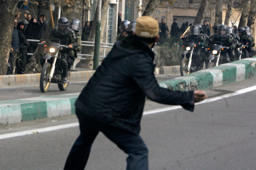 A protester throws a stone at riot police during fierce clashes in central Tehran on December 27, 2009. (REUTERS/Stringer) (via Three days in Iran - The Big Picture - Boston.com)
