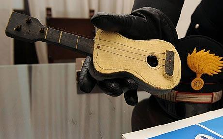 "bossa:  uncertaintimes:  Picasso's ""little guitar"" found in a shoebox A wee wooden guitar made by Pablo Picasso has been recovered 3 years after it was stolen by a con-man. Picasso made it for his daughter Paloma, but once it was finished he gave it instead to his friend, Italian artist Giuseppe Vittorio Parisi. Parisi kept it for decades, but when he was 92 (in 2007), an unnamed ""businessman"" persuaded him to part with it. The fraudster promised he'd create a special special wood and glass display case for the piece, but once he had it, he disappeared never to be seen again."