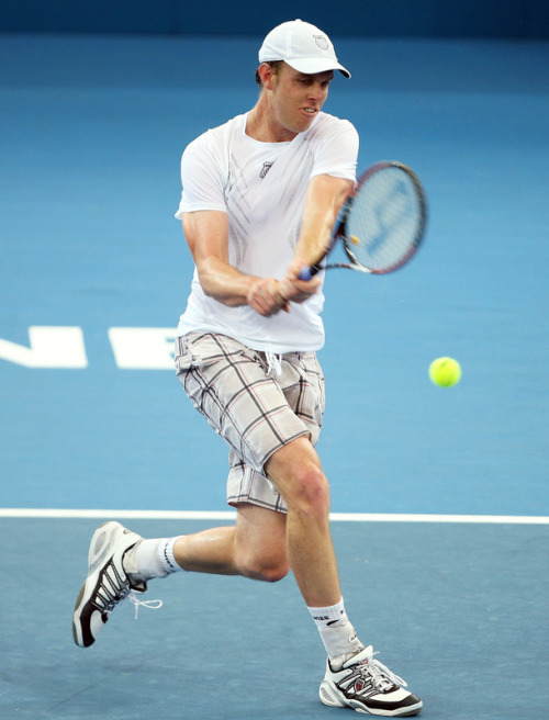 I am LOVING the plaid shorts that Sam Querrey rocked out in his first round loss to James Blake at the Brisbane International. Even though, since Sam is so tall, they sort of look like board shorts, I still love this look. Sam unfortunately lost in three tough sets to Blake, 4-6, 6-3, 6-4.