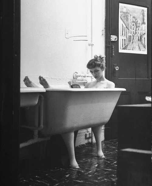 escatology:  nitescence:  jo ann kemmerling reading a book while taking bath; nina leen, 1954.