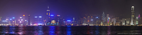"I'll see you in barely 2 weeks! :)  melreamico:  ""Hong Kong Skyline"" View from Tsim Tsa Chui - Symphony of Lights. Stitched 10 portrait shots to make a panorama. Zoom to appreciate. Technical details: Shot @ 70mm,f/8,1s,iso640 using Canon EOS 5D2 + Canon 70-200mm f/2.8L IS + Giottos MT8341 Tripod w/ MH702 ballhead"