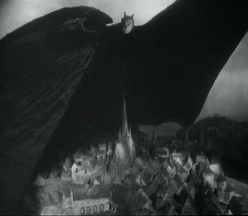 Emil Jannings, as the demon Mephisto, spreads his wings over the Earth & sows the seeds of plague in Faust (1926, dir. F. W. Murnau)