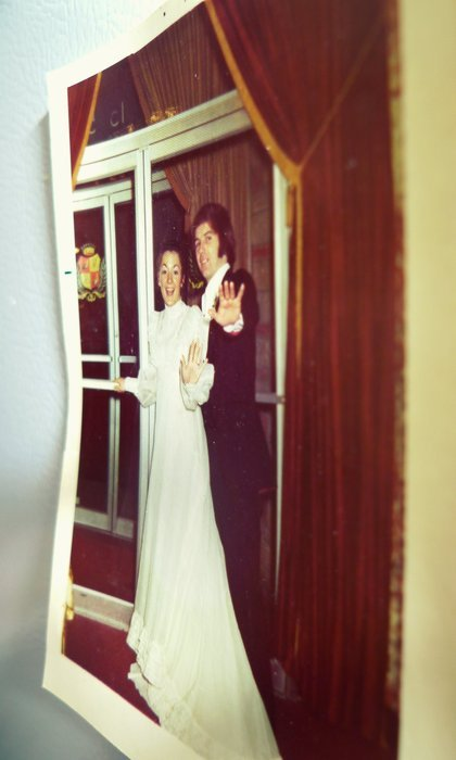 He and She Who Begat Me, on Their Wedding Day: 36 years ago yesterday.   Incidentally, I found out over Christmas that they didn't, as I'd always thought, buy our first house because they were having me.  Turns out they bought it because they were trying to get custody of Duncan, and their lawyer told them they'd have a better shot as homeowners.  They were unsuccessful, and my dad didn't get to participate all that much in raising his first kid.  The two of them sure participated the shit out of raising me, though. Anyway, they left the party in this here photo to go off and get horizontal, and they've been getting horizontal ever since.  Happy anniversary, you crazy kids.  Here's to hoping you're knockin boots for another 36.
