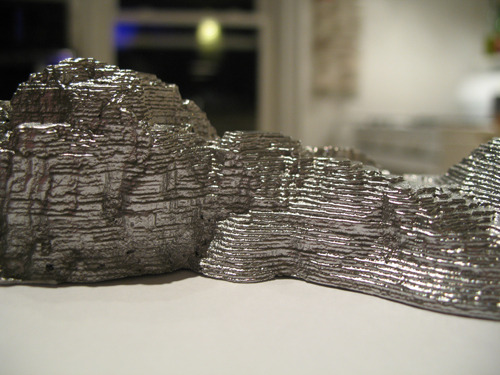 Detail of Lake Michigan in cast aluminum.
