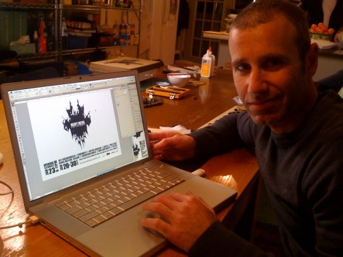 Designer Noam Lamdan working on the graphics for the exhibition.